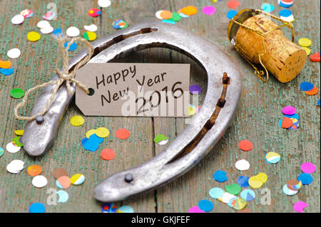 new year 2016 with horseshoes for good luck for success - Stock Photo