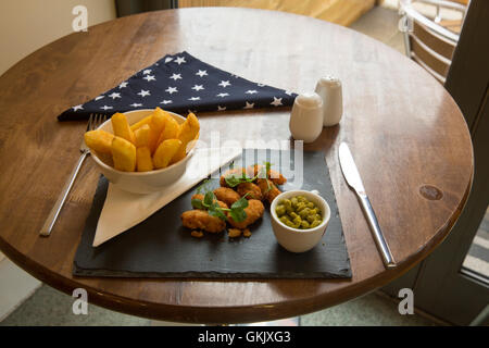 Scampi and chips with peas - Stock Photo