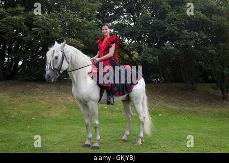 Celia Navaja with her Andulusian Stallion Xaired, a display incorporating dancing Spanish Lusitano and Andalusian - Stock Photo