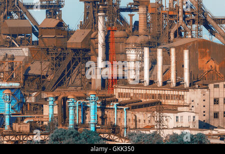 Industrial buildings . Steel factory at sunset. Pipes with smoke. Metallurgical plant. steelworks, iron works. Heavy industry in