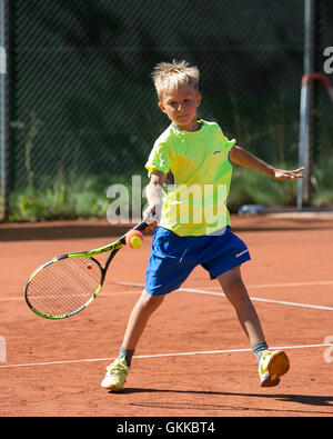 Young boy playing tennis. - Stock Photo