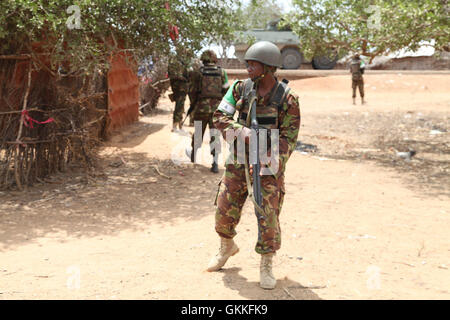Kenyan soldiers, as part of the African Union Mission in Somalia, get ready to go out on patrol in the recently - Stock Photo