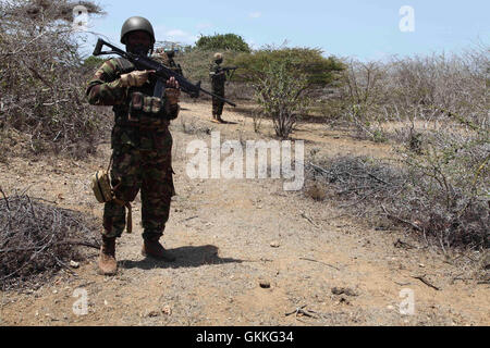 Kenyan soldiers, as part of the African Union Mission in Somalia,  go on patrol in the recently captured town of - Stock Photo