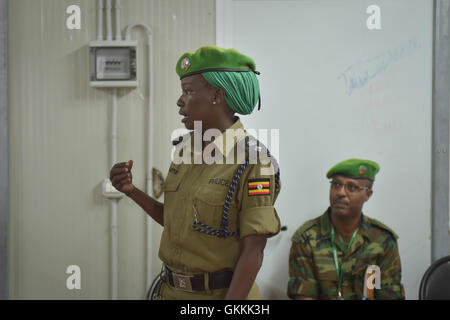 Soldiers belonging to the African Union Mission in Somalia (AMISOM) attend the closing ceremony of a training workshop - Stock Photo