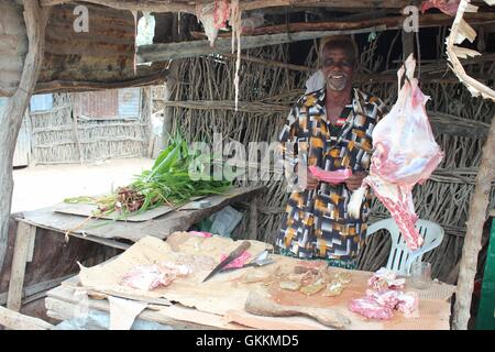 Meat seller in Baardheere district of Gedo region. Normalcy and businesses have resumed in Baardheere after Al-Shabaab - Stock Photo