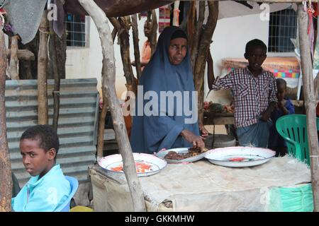 A woman sells vegetables in Baardheere district of Gedo region. Normalcy and businesses have resumed in Baardheere - Stock Photo
