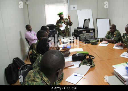 The AMISOM Military Chief of Staff Col. Daher Aden speaks during a radio communication training for AMISOM Public - Stock Photo