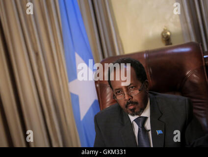 SOMALIA, Mogadishu: In photograph taken and released by the African Union-United Nations Information Support Team 19 April 2013, Somali President Hassan Sheik Mohamud is seen in his presidential office inside Villa Somalia, the complex which houses the Somali government in the country's capital Mogadishu. Listed in this year's Time Magazine list of the 100 most influential people, Mohamud is president of Somalia's first democratically elected government after two decades of civil war unrest and conflict in the Horn of Africa nation. AU-UN IST PHOTO / STUART PRICE.