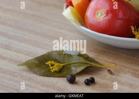 plate of pickled vegetable on wooden table - Stock Photo
