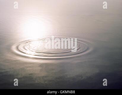 Water ripples on still water, Llyn Padarn lake, early morning light. Llanberis, Gwynedd, North Wales, UK - Stock Photo