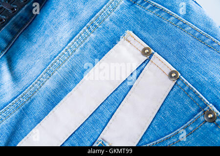 Fashionable jeans fabric of blue color in the form of a background - Stock Photo
