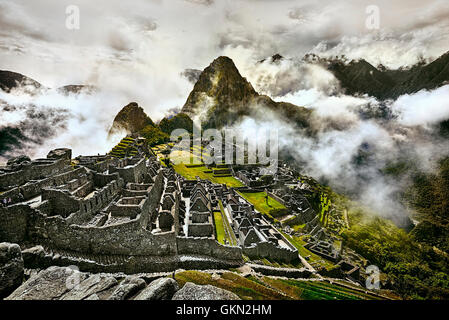 MACHU PICCHU, PERU - MAY 31, 2015: View of the ancient Inca City of Machu Picchu. The 15-th century Inca site.'Lost - Stock Photo