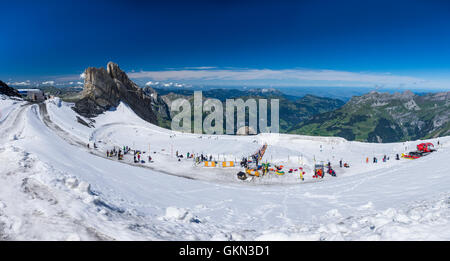 Panorama of the glacier park on Titlis glacier with various snow toys to try out during summer. Engelberg, Switzerland. - Stock Photo