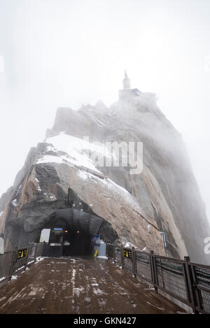 Lower terrace and summit tower at the top of the Aiguille Du Midi - Stock Photo