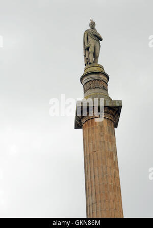 A gull sits on the head of the statue of Sir Walter Scott at the top of the Walter Scott Memorial Column. George - Stock Photo