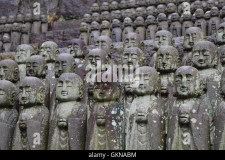Small Buddha statues in Japanese temple - Stock Photo