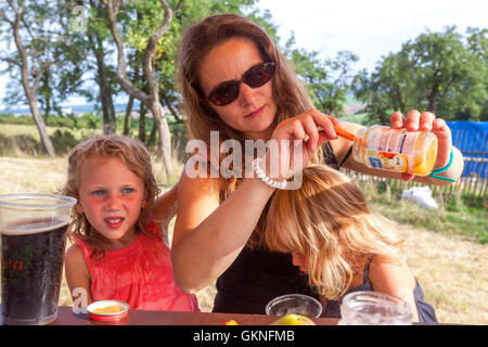 Mother with her two daughters, and Children's Snacks, Czech Republic - Stock Photo