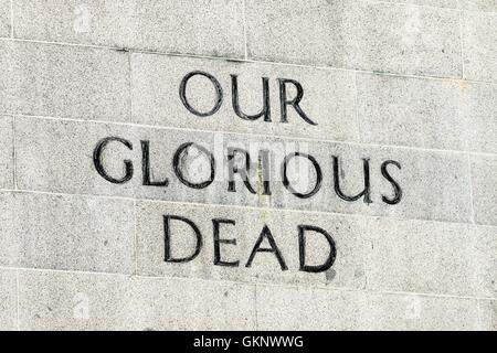 'Our Glorious Dead' inscription on the Cenotaph in Singapore. The memorial remembers the dead from World War 1 and - Stock Photo