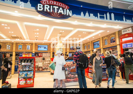 funny,royalty,The, Queen, greets tourists, at, tourist, shop, outlet 'Glorious Britain' gift shop. Departures Terminal, - Stock Photo
