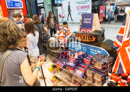 tourist,tourists,buying,looking,at,souvenirs,souvenir,gift,gifts,tourist shop outlet 'Glorious Britain' gift shop.Departures - Stock Photo