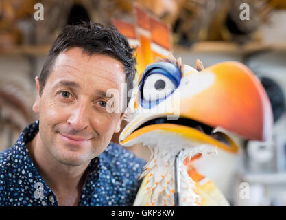 Hamburg, Germany. 10th Aug, 2016. Joachim Benoit, performer in the musical The Lion King poses with a puppet of - Stock Photo