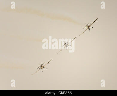Three planes from the Blades Aerobatic Air Display Team bank in formation at the Bournemouth Air Show against a - Stock Photo