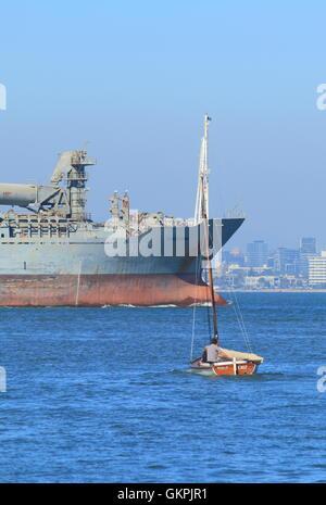 Tanker and small boat sail in Port Phillip Bay in Melbourne Australia. - Stock Photo