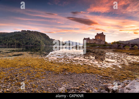 Stunning evening sky over Eilean Donan castle on the western coast of the Scottsih highlands - Stock Photo