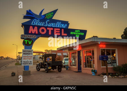 Historic Blue Swallow Motel at sunset - Stock Photo