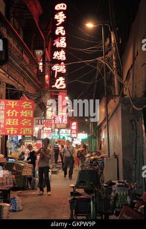Night scene of back street in Beijing China. - Stock Photo