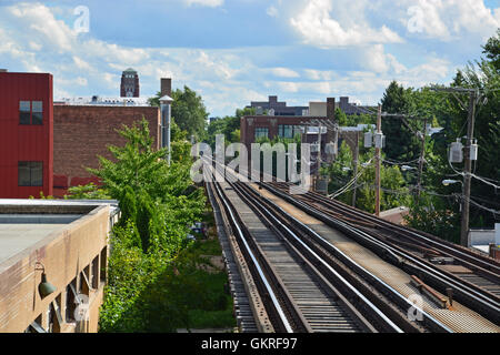 The elevated train tracks of the CTA Brown line head south from the Montrose Avenue station on the Brown Line - Stock Photo