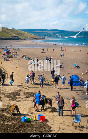 Donkey Rides on the west beach at Whitby North Yorkshire on a sunny day - Stock Photo