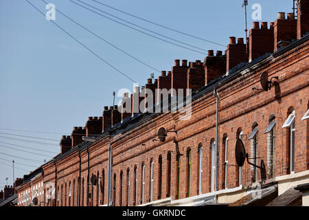 rows of chimneys on red brick victorian terraced townhouses rushfield avenue south belfast northern ireland - Stock Photo