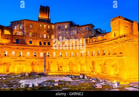 Rome, Italy. Twilight view of ancient Trajan's Market, ruins in Via dei Fori Imperiali, Roma. - Stock Photo