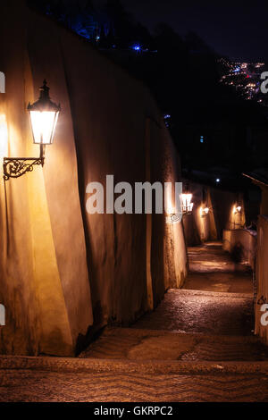 staircase alley with lanterns in Prague at night - Stock Photo