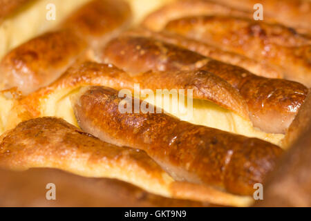 Lovely shot of a traditional British toad-in-the-hole meal of sausage with Yorkshire pudding - Stock Photo