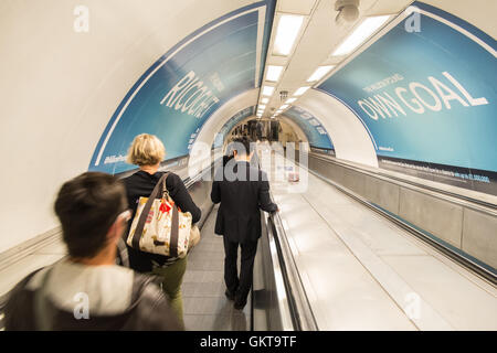 Commuters on walkway heading down to Tube station Bank for Bank-Waterloo line,London. London,financial,district,The - Stock Photo