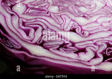 close up of colourful red cabbage sliced in half - Stock Photo