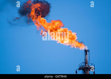 flaring of associated gas at oil refinery - Stock Photo