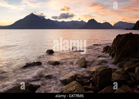 A sunset image taken from the beach at Elgol on the Isle of Skye - Stock Photo