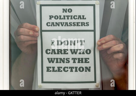 A disgruntled voter expresses their opinion on politicians and campaigners. - Stock Photo
