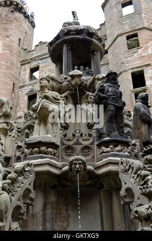Carved stone characters on the ornamental fountain in the royal Linlithgow Palace in Central Scotand. - Stock Photo