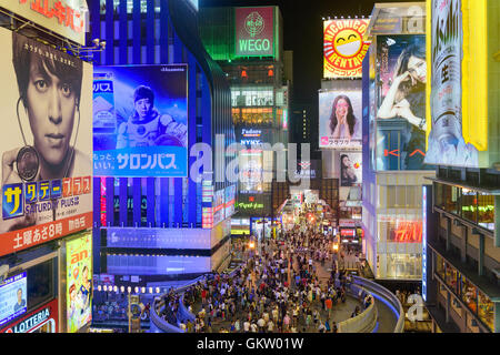 OSAKA, JAPAN - AUGUST 16, 2015: Pedestrians on Ebisu Bridge pass over Dotonbori Canal in the Namba District. The - Stock Photo