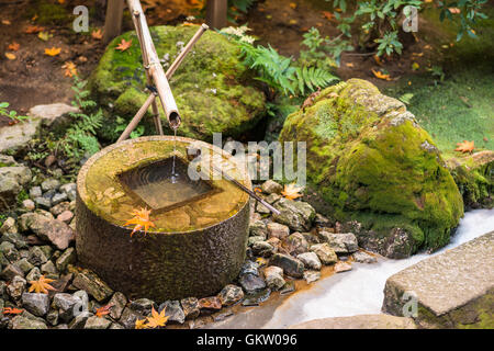Traditional basin for hand washing in Kyoto, Japan. - Stock Photo