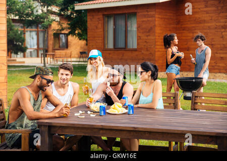 Group of happy young friends on outdoor summer party - Stock Photo