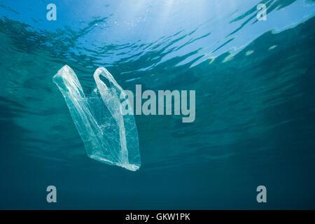 Plastic Bag adrift in Ocean, Ambon, Moluccas, Indonesia - Stock Photo