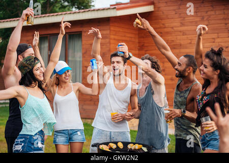 Group of cheerful young friends having fun outdoors - Stock Photo