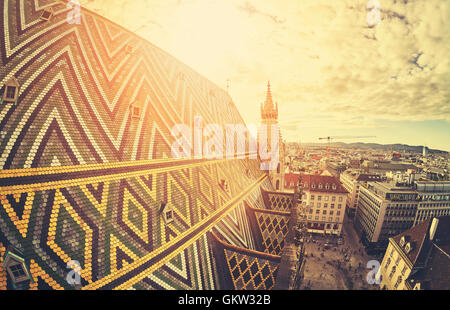 Retro stylized fisheye lens picture of Vienna at sunset, view from the north tower of St. Stephen's Cathedral, Austria. - Stock Photo