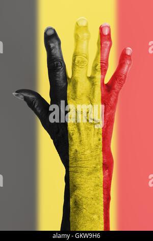 Old hand with flag, European Union, Belgium - Stock Photo