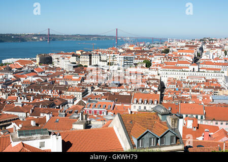 LISBON, Portugal - A view of the city of Lisbon and Tagus River, looking west from the walls of the castle. Sitting - Stock Photo